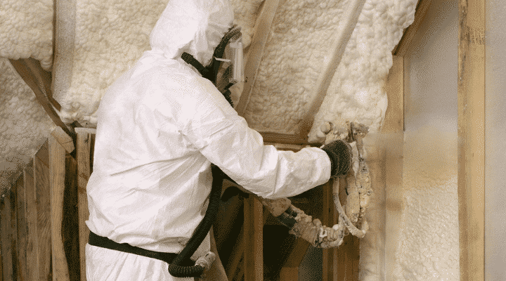 Spray foam technician working.